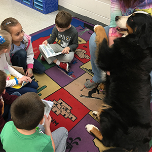 Poquoson Primary School Students Read with a Furry Friend